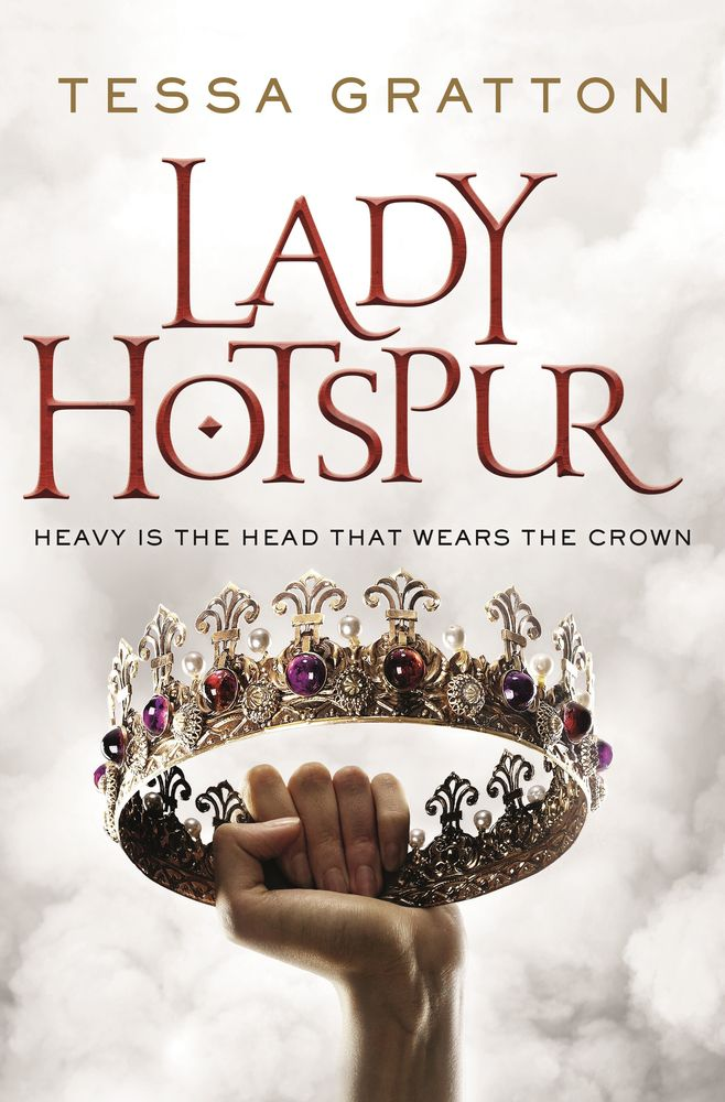 a hand holds a crown in the air in the lady hotspur book cover