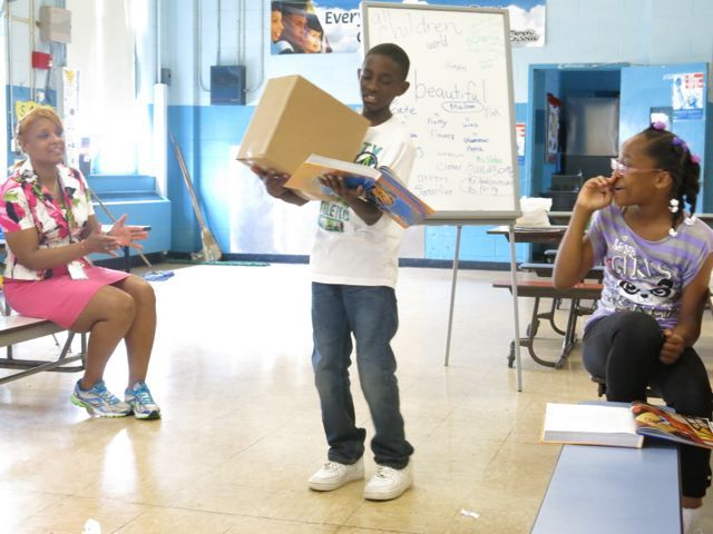 Joel Jordan portrays Louis the janitor during a class read-through of 'A Package for Mrs. Jewls' from Wayside School is Falling Down