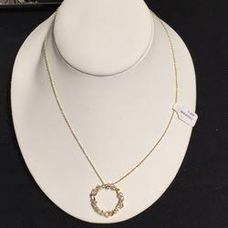 18K gold necklace, $897