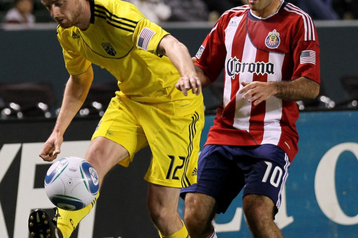 CARSON, CA - APRIL 9:  Eddie Gavin #12 of the Columbus Crew plays the ball in front of Nick LaBrocca #10 of Chivas USA at The Home Depot Center on April 9, 2011 in Carson, California.   (Photo by Stephen Dunn/Getty Images)