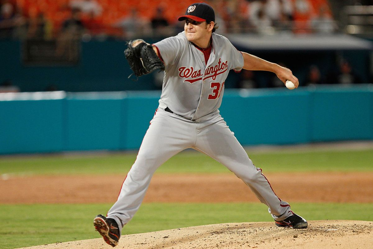 MIAMI GARDENS, FL - SEPTEMBER 27:  John Lannan #31 of the Washington Nationals pitches during a game against the Florida Marlins at Sun Life Stadium on September 27, 2011 in Miami Gardens, Florida.  (Photo by Mike Ehrmann/Getty Images)