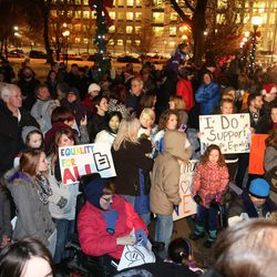 About 1,500 people gather to celebrate a federal judge's decision legalizing same-sex marriage in Utah at the Salt Lake City-County Building on Monday, Dec. 23, 2013, in Salt Lake City.