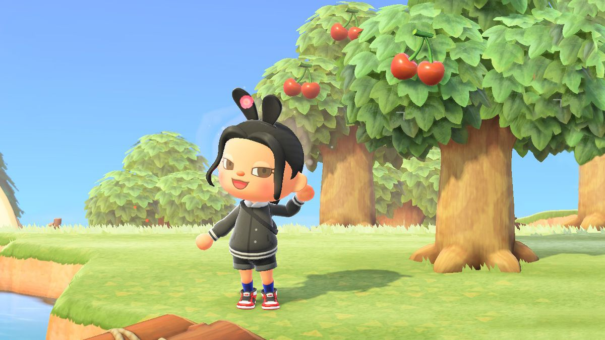 An Animal Crossing character wearing rabbit ears blushes by some trees