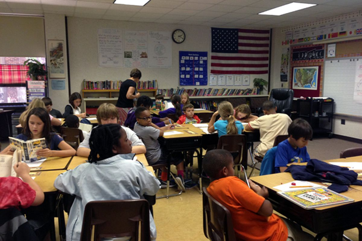A teacher checks in on students during a lesson in Washington Township.