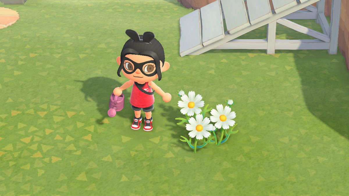 An Animal Crossing character stands next to some white cosmos