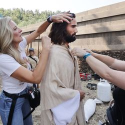 Anthony Butters, who plays Jesus, is made up by Becky Swasey, left, and Sadie Nagle as The Church of Jesus Christ of Latter-day Saints' production of the fourth season of Book of Mormon videos filmed near Springville on Monday, July 26, 2021.