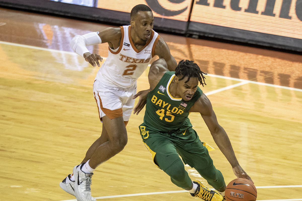 Baylor Bears guard Davion Mitchell drives up the court against Texas Longhorns guard Matt Coleman III in the second half of an NCAA college basketball game at the Frank Erwin Center on Tuesday, Feb. 2, 2021, in Austin, TX.