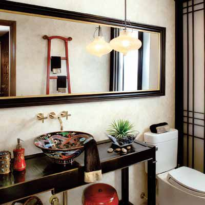 Wide rectangular mirror with dark frame that goes over both sink and toilet.