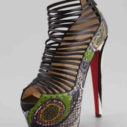 """Oh yes, the """"Zoulou"""", a dyed python, strappy black peep toe with a 6″ heel height and 2.5″ platform. Available at Louboutin or Neiman's for $2,095."""