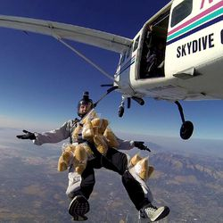 David McAlhany is attached with teddy bears as he skydives over Labor Day weekend.