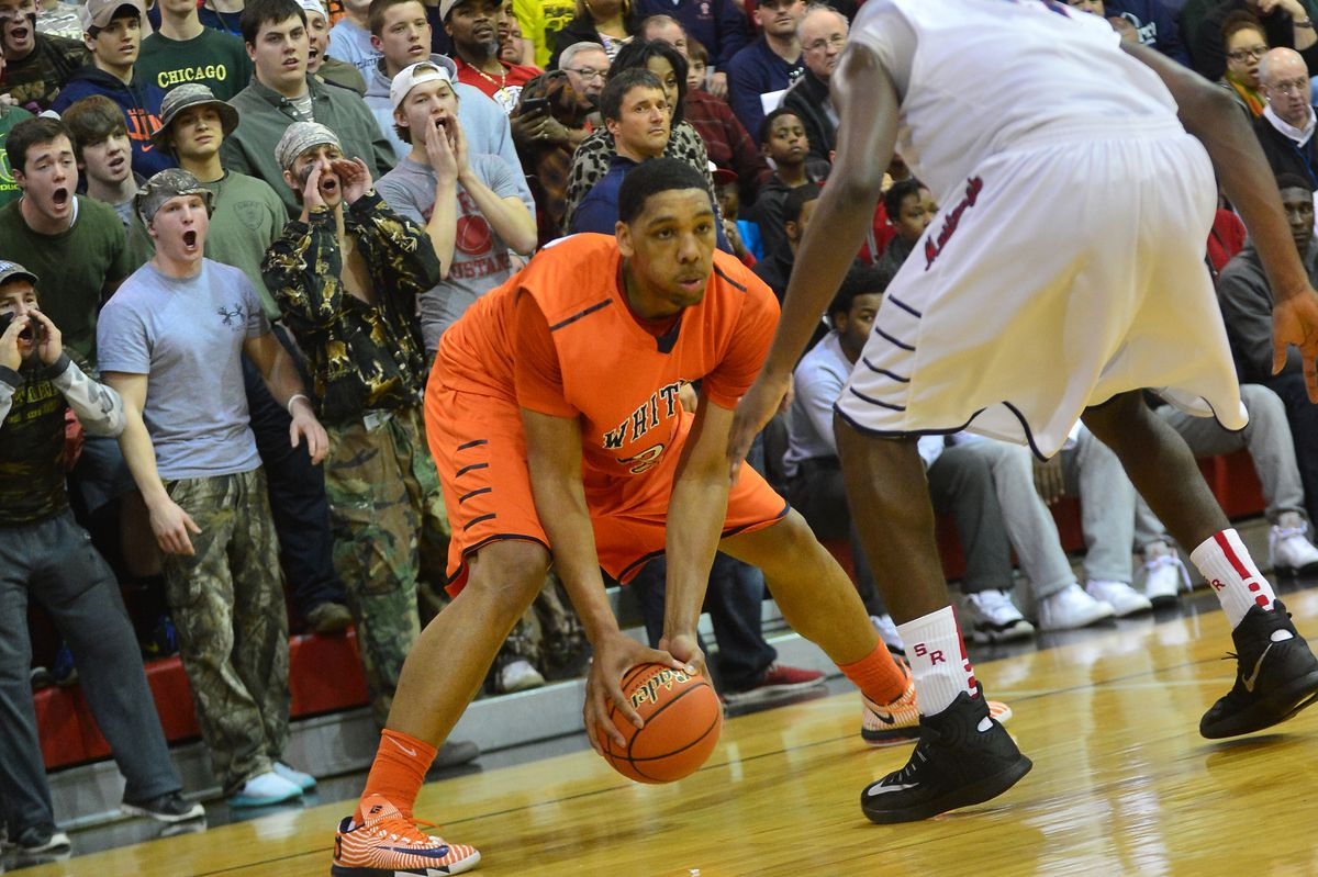 Young's Jahlil Okafor looks to move inside, as St. Rita fans scream from behind.
