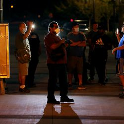 Counterprotesters shine high-powered flashlights at two protesters taking video and photos during a demonstrationat the West Valley City Police Department on Wednesday, Sept. 16, 2020.