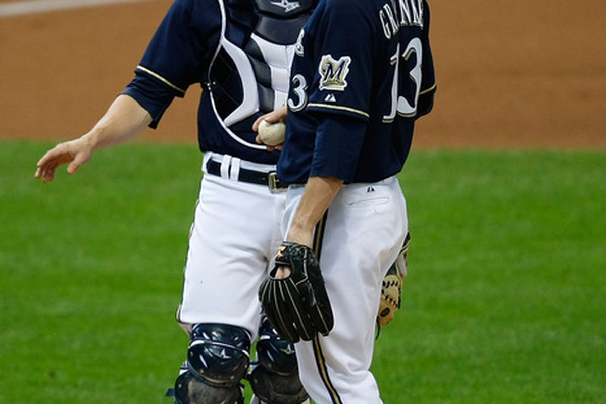 MILWAUKEE, WI - MAY 9: Zack Greinke #13 of the Milwaukee Brewers talks with Jonathan Lucroy #20 during the game against the Cincinnati Reds at Miller Park on May 9, 2012 in Milwaukee, Wisconsin. (Photo by Scott Boehm/Getty Images)