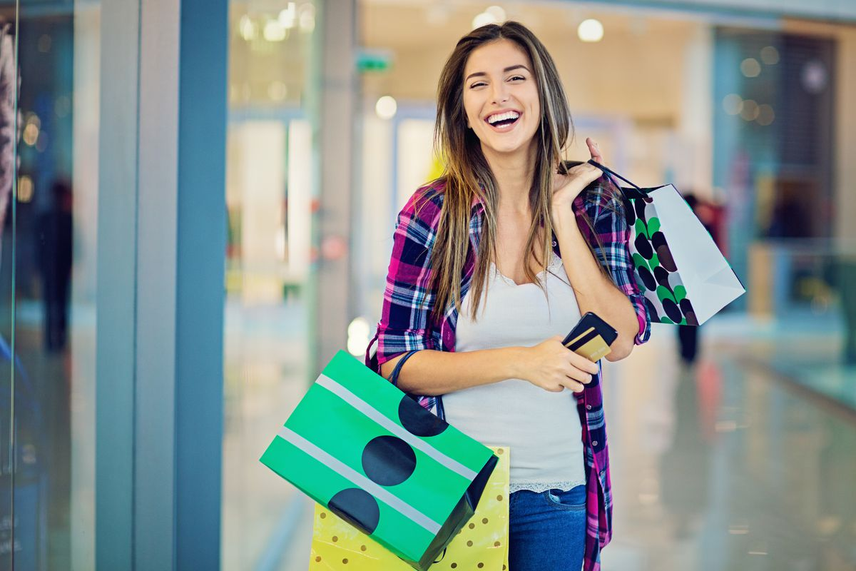 Woman laughing with shopping bags