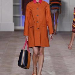 """This September 2011 photo courtesy of Tommy Hilfiger, U.S.A., shows a model wearing a design from the Tommy Hilfiger Spring 2012 women""""™s collection during Fashion Week in New York. Pantone has chosen a reddish-orange hue as their top color of the year for 2012."""