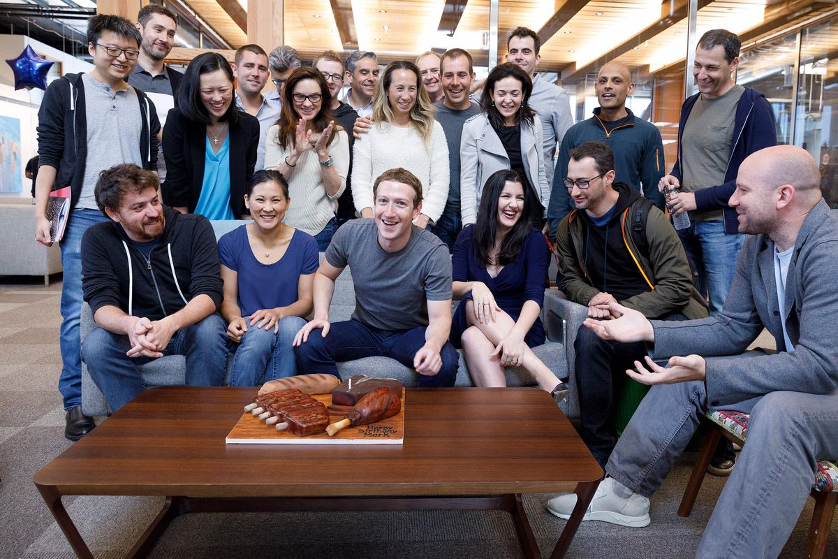 Members of Facebook's product and engineering teams are shown celebrating Facebook CEO Mark Zuckerberg's birthday.