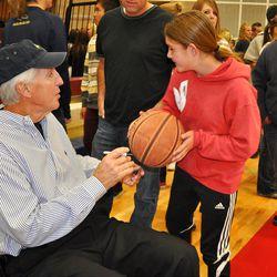 Retired Utah Jazz coach Jerry Sloan gave plenty of autographs to grateful fans at Herriman High School's meet-the-team night.