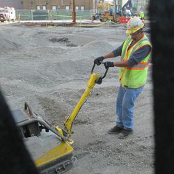 10:30 a.m. Gravel being leveled off in the broadcast lot -