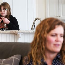 Heidi Wallis talks as her oldest daughter, Sam, who shares a rare disease — guanidinoacetate methyltransferase (GAMT) deficiency — with her brother, Louie, eats an after-school snack in the kitchen of their Bluffdale home on Wednesday, Nov. 2, 2016. Heidi Wallis and her husband, Trey, are fighting to have GAMT screening placed on the national newborn screening list.