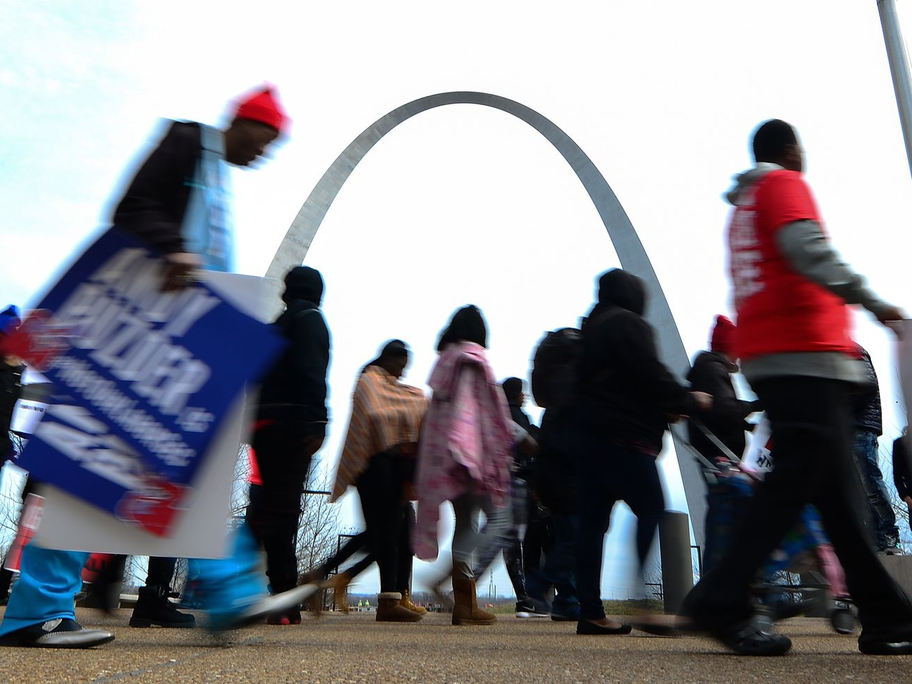 Fast-food workers walk to a rally outside the Hardee's headquarters in St. Louis, Missouri, on February 13, 2017.
