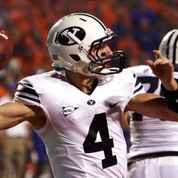Taysom Hill (4) of the Brigham Young Cougars throws a pass during NCAA football in Boise, Thursday, Sept. 20, 2012.