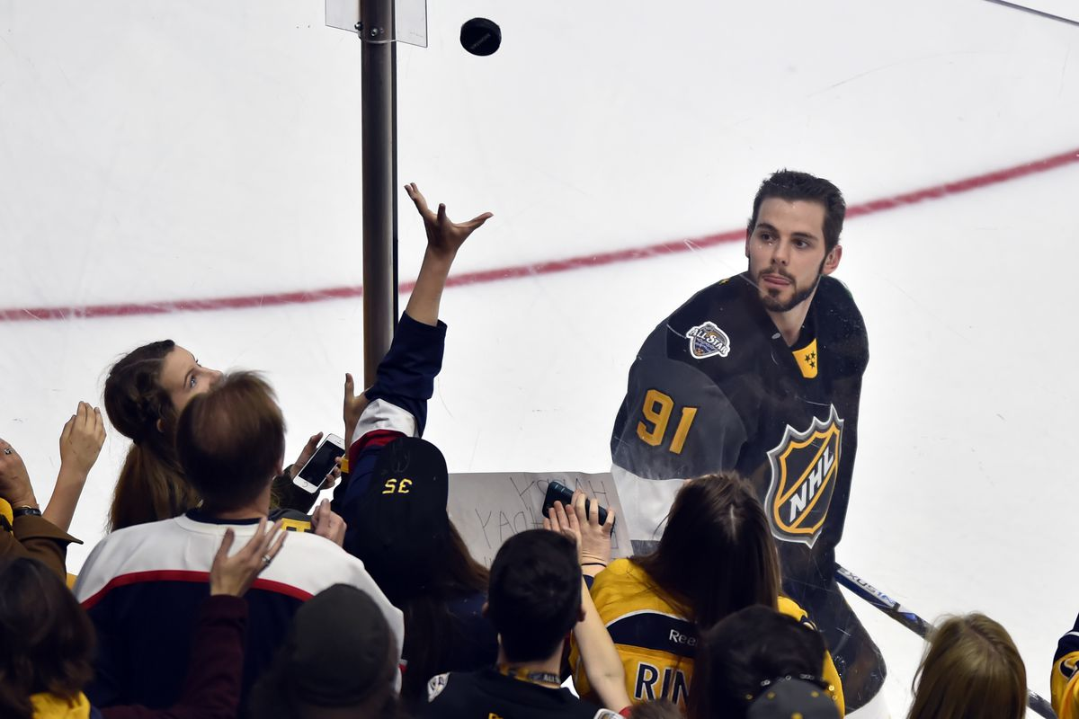 Flipping souvenir pucks to screaming fans is a kind of part-time job for Tyler Seguin.