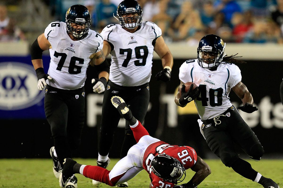 JACKSONVILLE, FL - AUGUST 19:  DuJuan Harris #40 of the Jacksonville Jaguars runs past Rafael Bush #36 of the Atlanta Falcons during a game at EverBank Field on August 19, 2011 in Jacksonville, Florida.  (Photo by Sam Greenwood/Getty Images)
