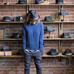 <b>Anna Delis</b>, Design Director, wearing a GANT shirt, Scotch and Soda jeans, Jack Purcell tennis shoes, a Goorin Bros. hat, and Moscot glasses.<br> <b>What have you learned at Goorin Bros. that you never would have learned elsewhere?</b><br> I have l