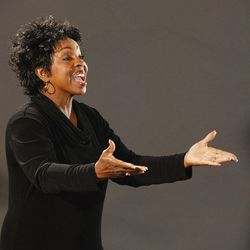 Gladys Knight conducts the Saints Unified Voices choir.