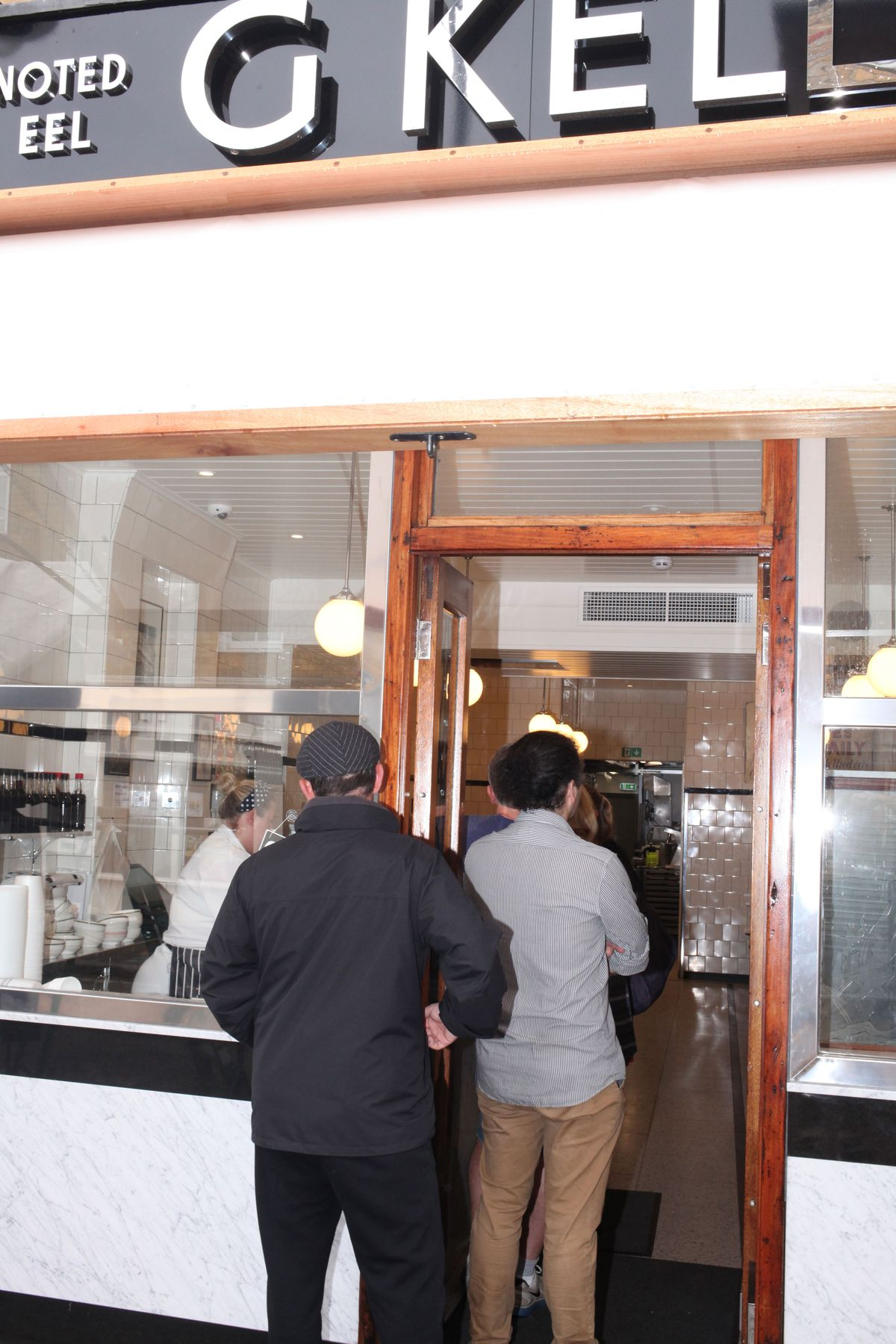 A queue out of the door at G. Kelly on Roman Road, east London