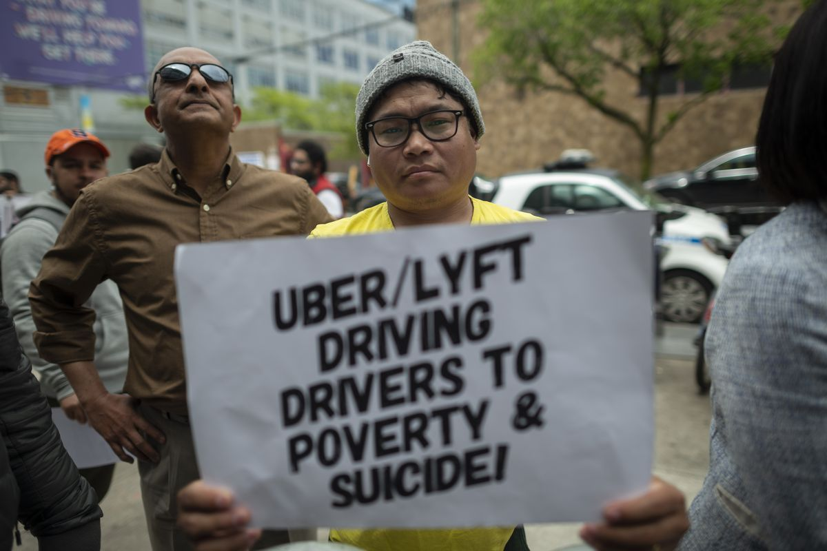 Hundreds of Uber and Lyft drivers rally in San Francisco for