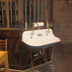 Pedals at the base of the sink allow for cleaner hand-washing.