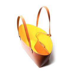 """<b>Large Tote</b> in cammello with sun interior, <a href=""""http://mansurgavriel.com/large-tote-cammello-with-sun/"""">$435</a>"""