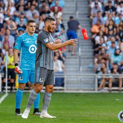 July 13, 2019 - Saint Paul, Minnesota, United States - Minnesota United defender Michael Boxall (15) and Minnesota United midfielder Ethan Finlay (13) take a water break during the match against FC Dallas at Allianz Field.