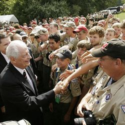Elder Robert D. Hales, of the Quorum of the Twelve Apostles of The Church of Jesus Christ of Latter-day Saints, shakes hands with Scouts after 3,500 LDS Scouts and leaders attended sacrament meeting outdoors at the National Scout Jamboree in Fort A.P. Hill, Va., on Sunday.