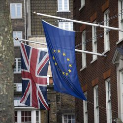 A European, right, and Union flags are displayed outside Europe House, the European Parliament's British offices, in London, Wednesday, June 22, 2016. Britain votes whether to stay in the European Union in a referendum on Thursday. (AP Photo/Matt Dunham)