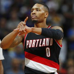 Portland Trail Blazers guard Damian Lillard gestures after hitting the winning basket with .3 seconds remaining in overtime of an NBA basketball game against the Denver Nuggets on Saturday, Oct. 29, 2016 in Denver. Portland won 115-113. (AP Photo/David Zalubowski)