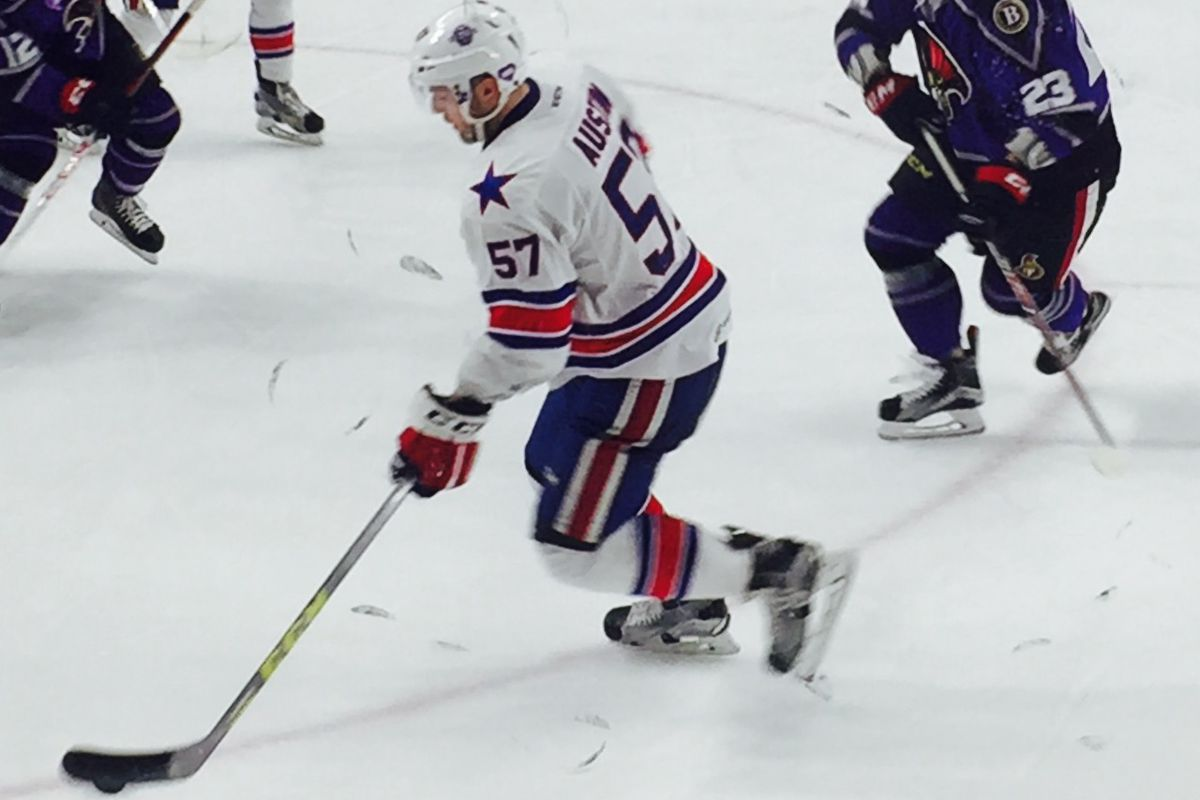 Rochester defenseman Brady Austin goes deep in the offensive zone in game with the Senators