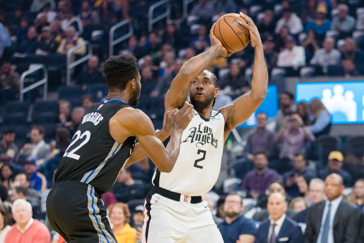 LA Clippers forward Kawhi Leonard shoots as Golden State Warriors guard Andrew Wiggins defends in the first half at Chase Center.
