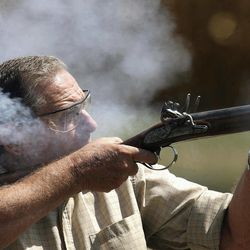 In an Aug. 23, 2012 photo, Chuck Lindsey fires a double-barreled, flintlock shotgun he built during trapshooting practice with friends in rural southwest Logan County, Ill.  Lindsey builds muzzle-loading firearms, especially flintlocks that were in use in the late 18th and early 19th centuries.