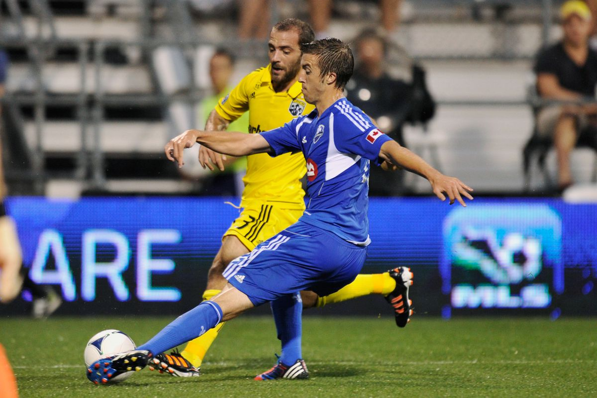 COLUMBUS, OH - SEPTEMBER 1:  Jeb Brovsky #15 of the Montreal Impact blocks a shot attempt from Federico Higuain #33 of the Columbus Crew in the first half on September 1, 2012 at Crew Stadium in Columbus, Ohio.  (Photo by Jamie Sabau/Getty Images)