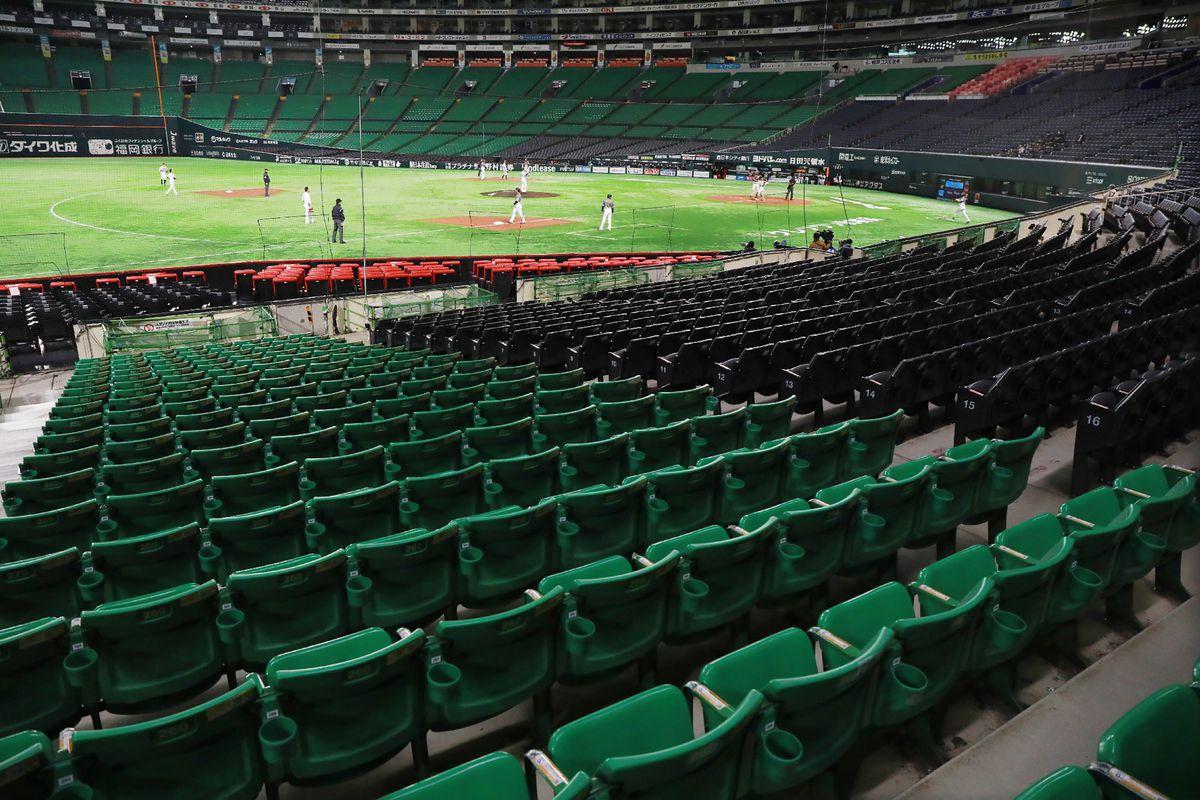 This picture shows a pre-season baseball games behind closed doors, between Hanshin Tigers and Fukuoka Softbank Hawks in Fukuoka on February 29, 2020.