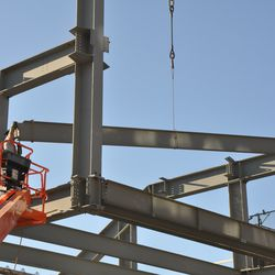 Girder being moved into place in right field -