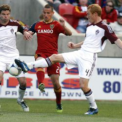 Luis Gil of Real Salt Lake battles for control of the ball against Drew Moor and Jeff Larentowicz of the Colorado Rapids during their MLS match up at Rio Tinto Stadium in Sandy Saturday, April 7, 2012.