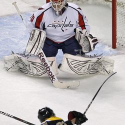 Washington Capitals goalie Braden Holtby (70) drops to the ice to make a save on a shot by Boston Bruins left wing Brad Marchand
