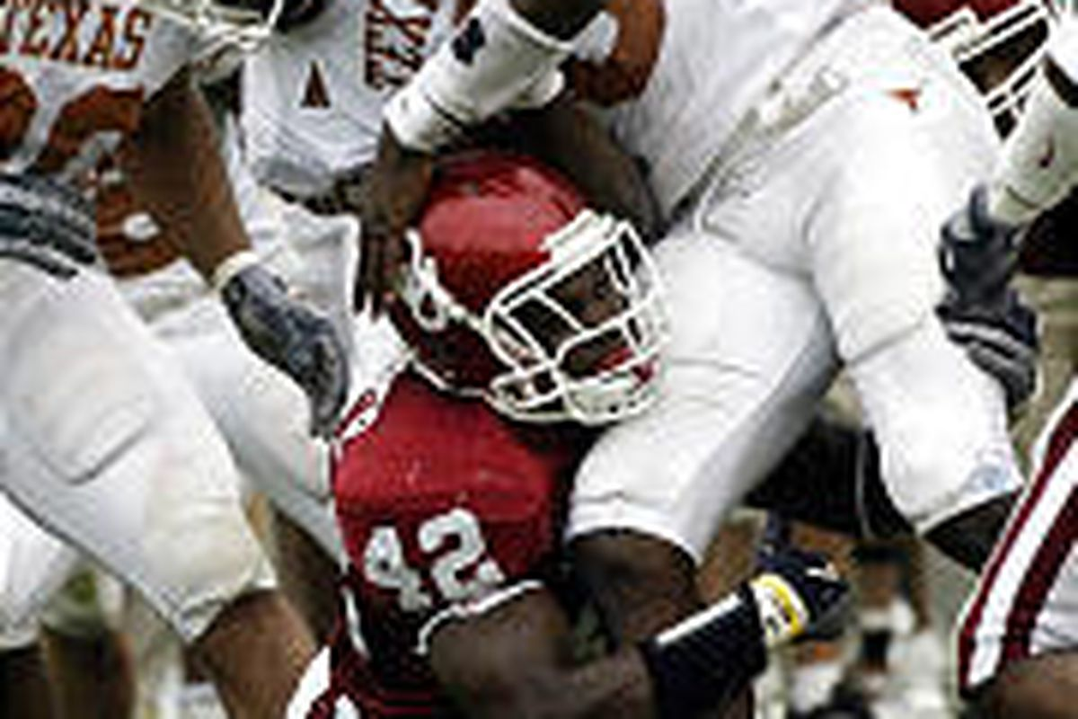 Oklahoma's Rufus Alexander (42) strips the ball from Texas QB Vince Young during the second quarter.