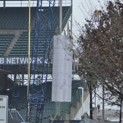 A cylinder being lowered in the left-field bleachers
