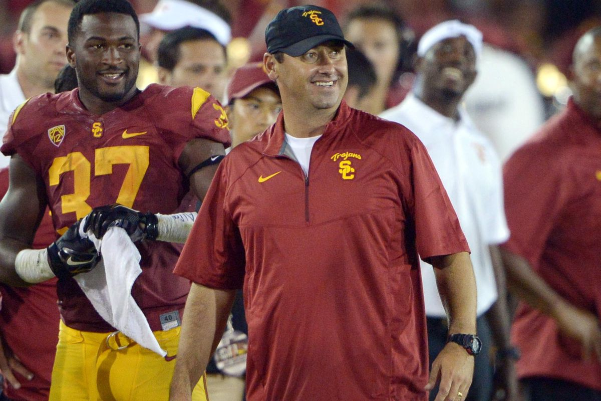 Coach Sark was all smiles in his debut as the new USC football coach.