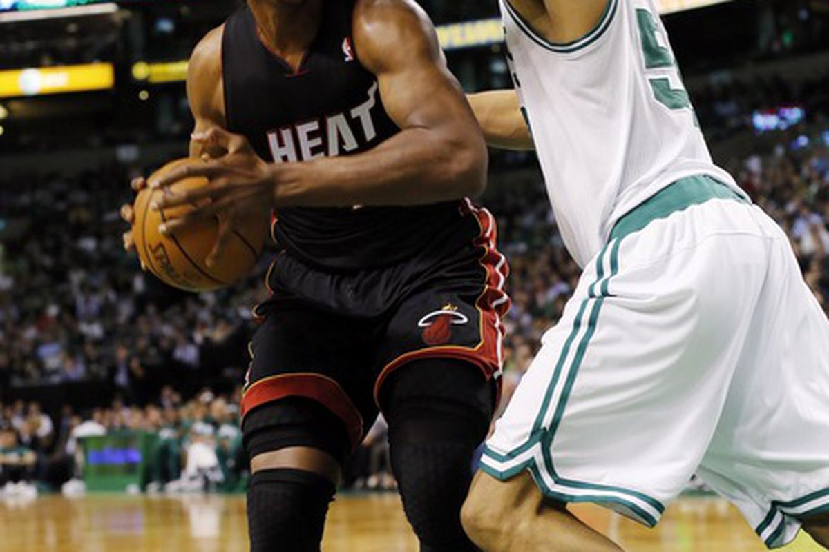 April 24, 2012; Boston, MA, USA; Miami Heat center Dexter Pittman (45) is guarded by Boston Celtics center Ryan Hollins (50) during the first quarter at TD Banknorth Garden.   Mandatory Credit: Greg M. Cooper-US PRESSWIRE