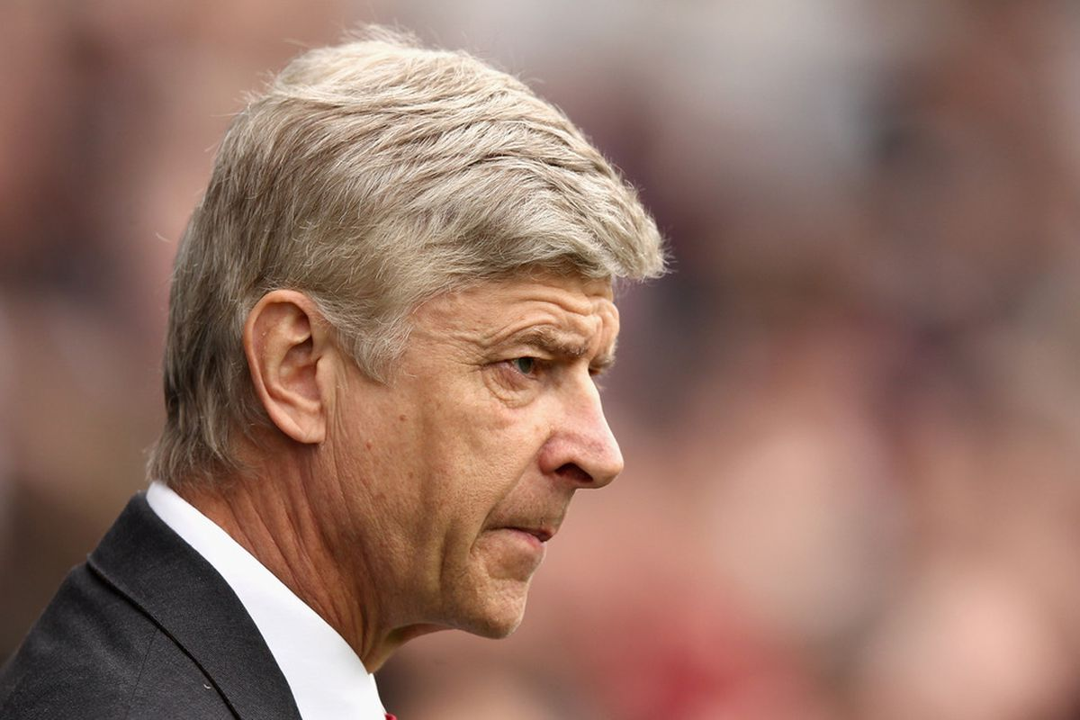 LONDON, ENGLAND - MARCH 31:  Arsenal manager Arsene Wenger looks on ahead of the Barclays Premier League match between Queens Park Rangers and Arsenal at Loftus Road on March 31, 2012 in London, England.  (Photo by Ian Walton/Getty Images)